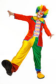Funny clown in colorful costume