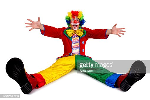 Funny clown sitting with arms and legs outstretched
