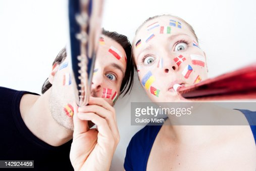 Funny couple with flag paintings : Stock Photo