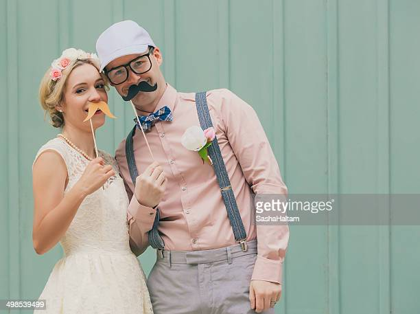 Funny couple with mustaches on wedding day