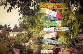 Funny directions signpost with distance to many different countries, cities and places