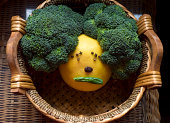 Funny face made from grapefruit and broccoli