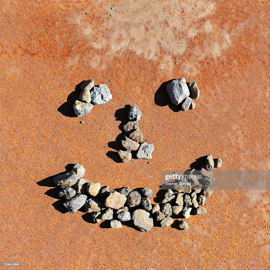 Funny face made of stones : Stock Photo