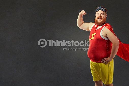 A funny fat man in a superhero costume : Foto de stock