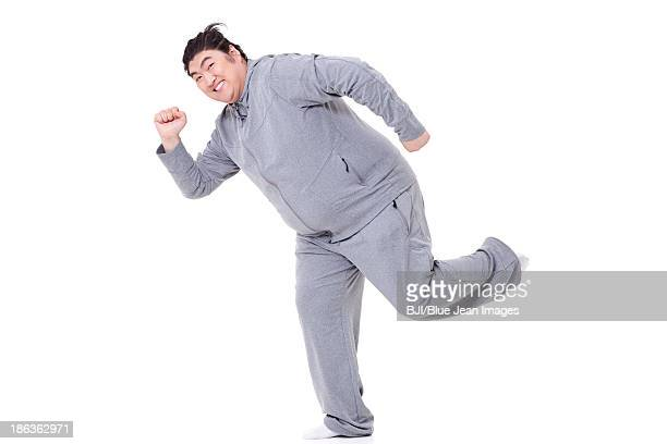 Funny fat man in running posture