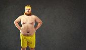 Funny fat naked man in sportswear. Humor and freak in sports.