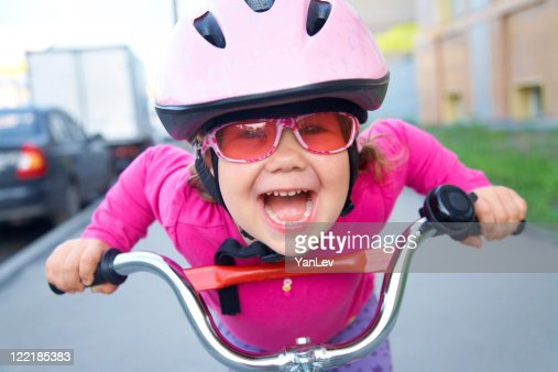 funny girl and bicycle : Stock Photo