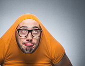 Funny thoughtful man looking up, isolated on gray background. Closeup, studio shot