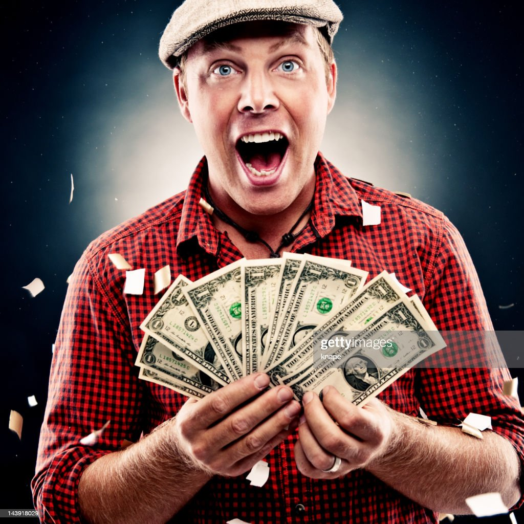Funny guy with dollars : Stock Photo