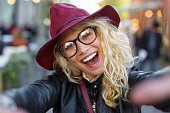 Funny hipster woman taking selfie