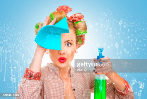 Funny housewife with rag / wipe and cleaning : Stock Photo