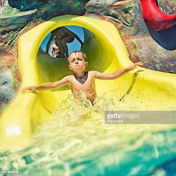 Funny little boy in water park