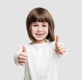 Cute little girl giving thumbs up