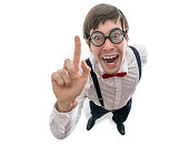 Funny man had an idea and holds finger up. Isolated on white background. View from top.