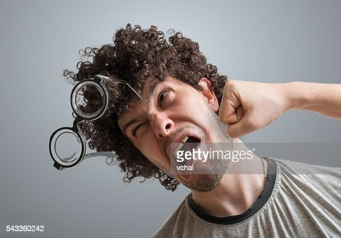 Funny man is getting punch in face with fist. : Stock Photo