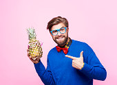 Funny man posing with pineapple
