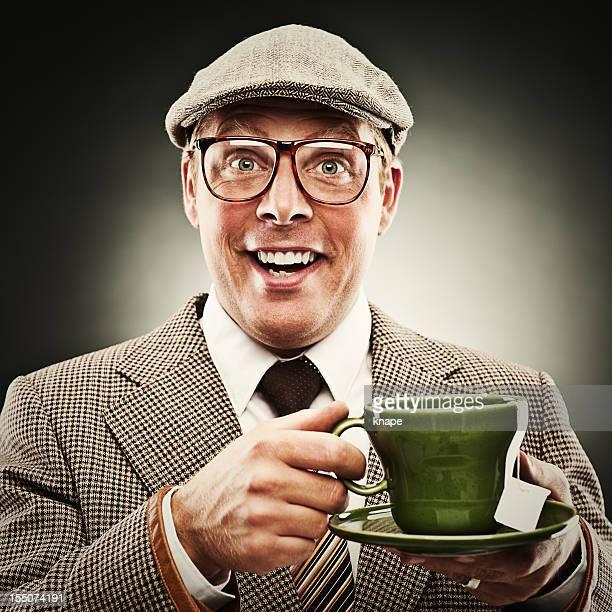 Funny man smiling with tea wearing porkpie hat
