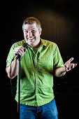 Comedian with microphone.