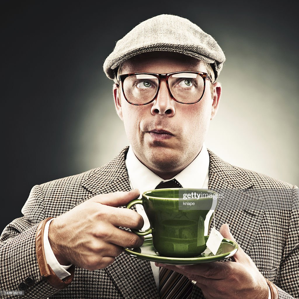 Funny man with tea : Stock Photo