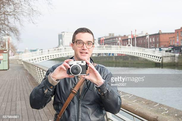 Lustiger Fotografen in der Stadt