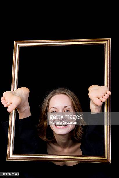 Funny picture, woman with toes in picture frame