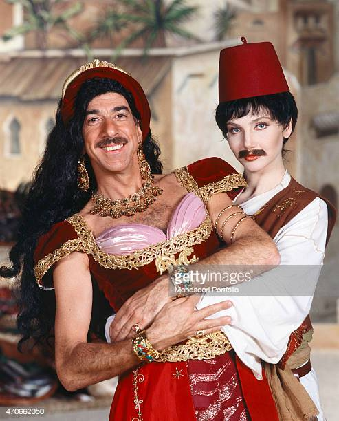 'A funny portrait of the two hosts of the entertainment broadcast ''Paperissima'' with Marco Columbro dressed as an eastern princess and Lorella...