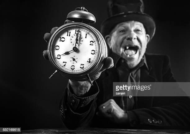 Funny senior man with alarm clock