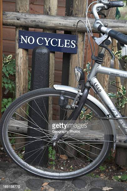 Funny shot of bicycle next to sign saying No Cycles Cambridge England