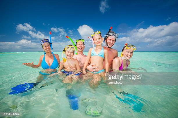 funny tourists in tropical sea