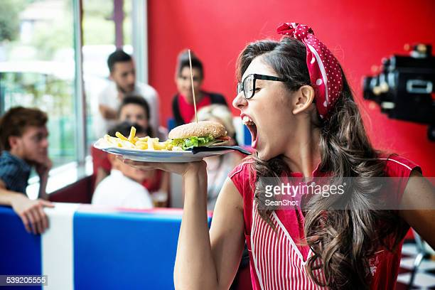 Funny Waitress and Hamburger with French Fries