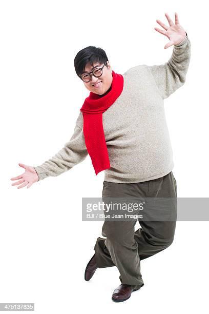 Funny young man dancing