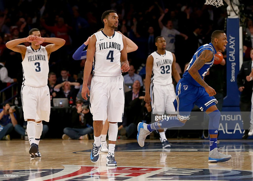 Fuquan Edwin #23 of the Seton Hall Pirates celebrates the win as Josh Hart #3,<a gi-track='captionPersonalityLinkClicked' href=/galleries/search?phrase=Darrun+Hilliard&family=editorial&specificpeople=8710176 ng-click='$event.stopPropagation()'>Darrun Hilliard</a> II #4 and <a gi-track='captionPersonalityLinkClicked' href=/galleries/search?phrase=James+Bell+-+Basketball+Player&family=editorial&specificpeople=15119578 ng-click='$event.stopPropagation()'>James Bell</a> #32 of the Villanova Wildcats react to the loss during the quarterfinals of the Big East Basketball Tournament at Madison Square Garden on March 13, 2014 in New York City.Seton Hall Pirates defeated the Villanova Wildcats 65-63.