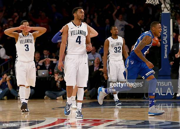 Fuquan Edwin of the Seton Hall Pirates celebrates the win as Josh HartDarrun Hilliard II and James Bell of the Villanova Wildcats react to the loss...