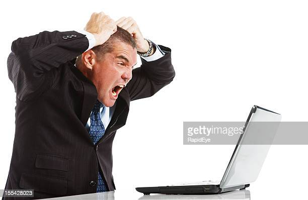 Furious frustrated businessman loses temper with laptop