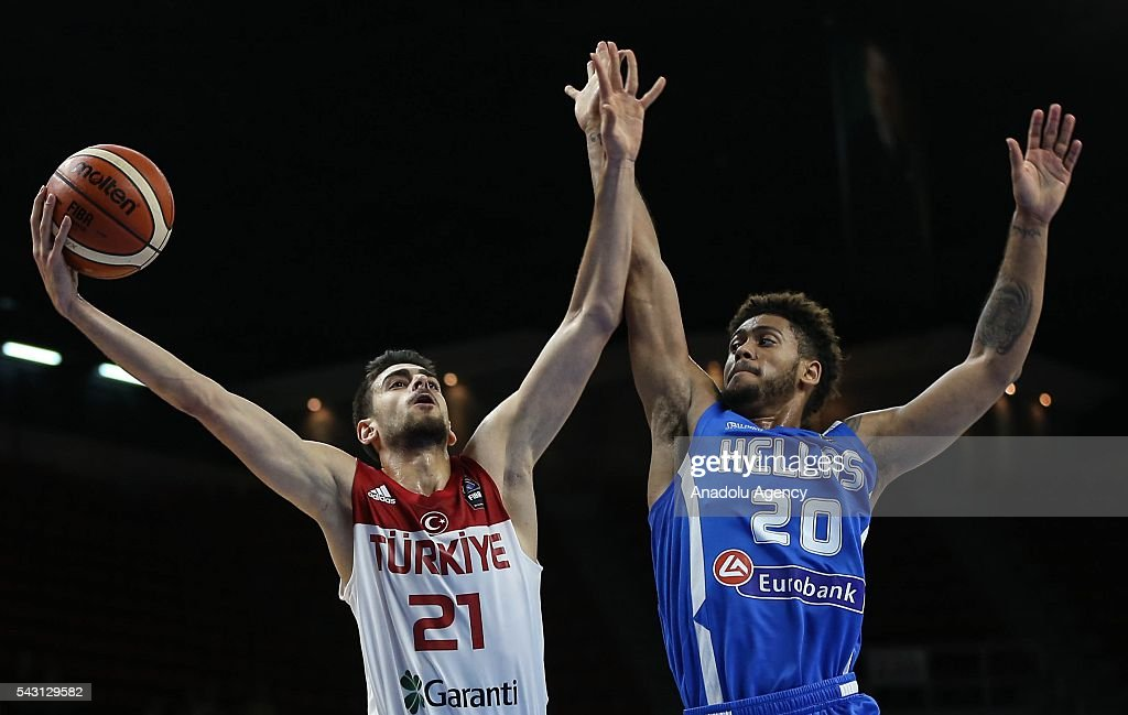 Furkan Korkmaz (21) of Turkey in action against Tyler Dorsey (20) of Greece during the friendly match at Abdi Ipekci Sports Hall in Istanbul, Turkey on June 26, 2016.