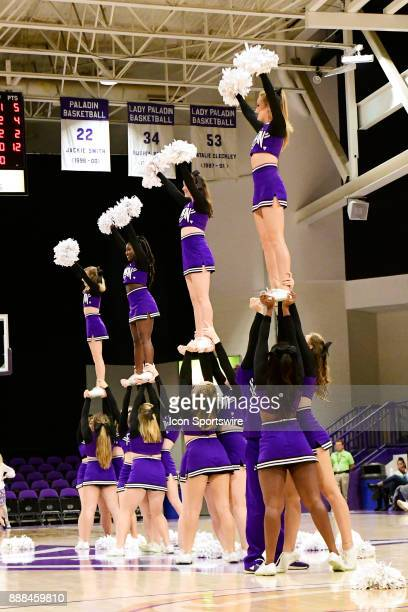 Furman University Paladins cheerleaders perform a stunt during a break in the game with the UNC Asheville Bulldogs Tuesday December 5 at Timmons...
