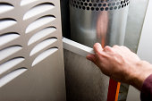 Furnace maintenance with hand removing dirty filter