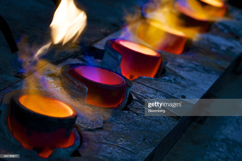 Furnaces heat crucibles containing molten gold before they are poured into moulds during the semiautomated gold bar manufacturing process at a...