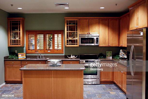 a furnished kitchen is displayed at the kb home studio unit - Kb Homes Design Studio