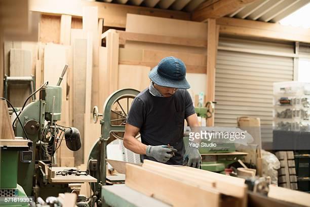 Furniture craftsman working in carpentry workshop
