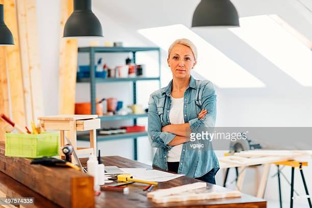 Furniture Designer In Her Workshop.