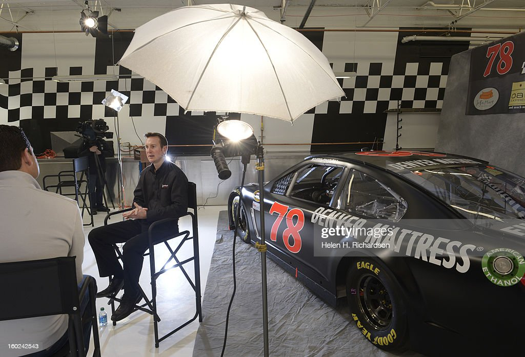 Furniture Row Racing driver Kurt Busch is pictured in front of the company's Sprint Cup Car #78 while he is interviewed by local Denver television reporter Arran Andersen. Furniture Row Racing announced their new at the team shop at 4000 Forest Street in Denver on January 24th, 2013. This is the only NASCAR race shop west of the Mississippi. The team is preparing their 2013 NASCAR Sprint Cup car #78 for the season opener at Daytona 500.