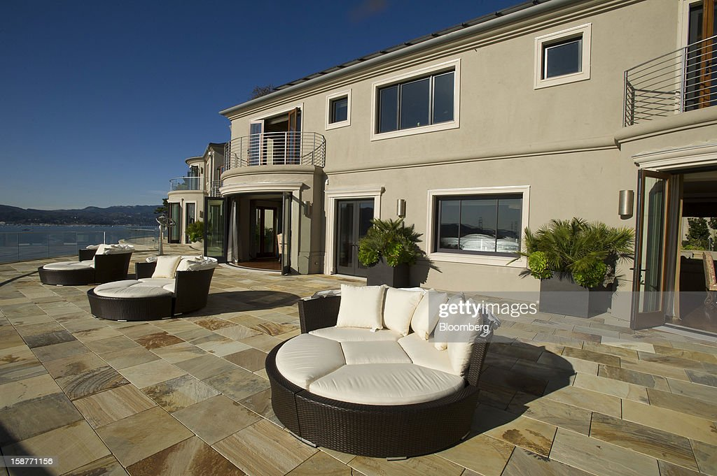 Furniture sits on the terrace of a 15,000 square-foot custom built home on Belvedere Island in Marin County, California, U.S., on Wednesday, Dec. 19, 2012. The builder couldn't find a buyer for the brand-new waterfront mansion he listed in January for $45 million. He hopes one will turn up at a Dec. 30 auction, where the starting bid will be $25 million. Photographer: David Paul Morris/Bloomberg via Getty Images
