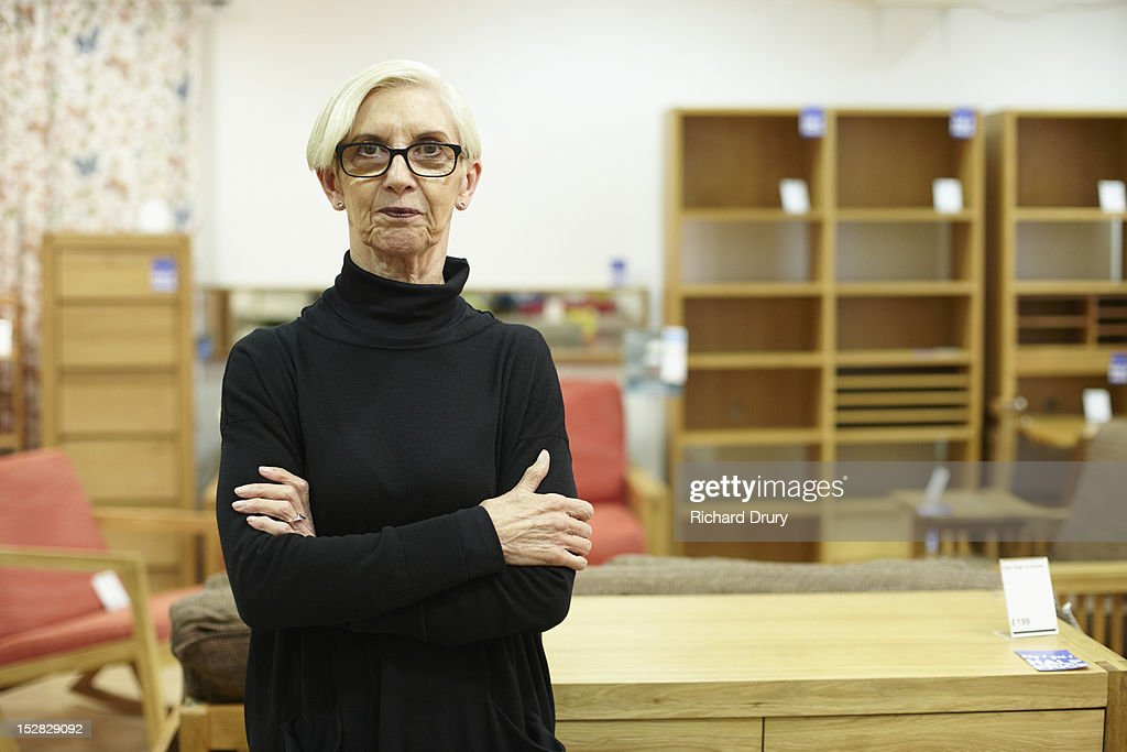 Furniture store manager in her shop : Stock Photo