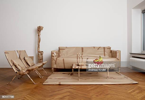 Furniture that has been wrapped up in a living room Sweden.