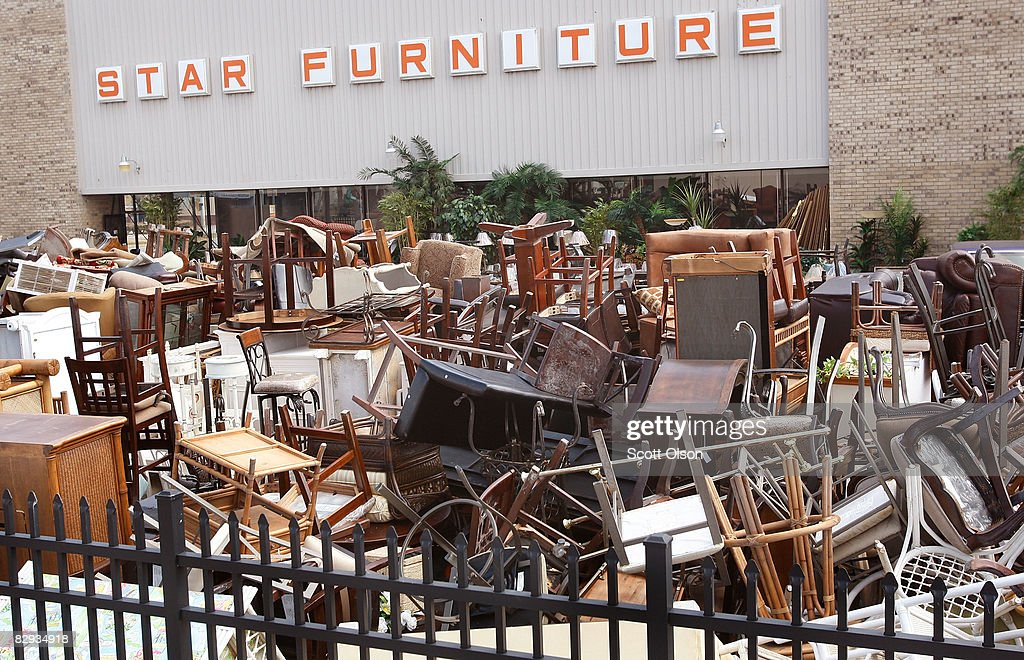Furniture that once filled nearly the entire showroom sits in the parking lot of Star Furniture after it was destroyed by flooding during Hurricane...