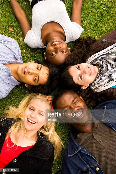 further education: circle of diverse teenage friends with bright smiles