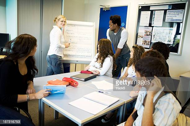 further education: contemporary classroom scene with diverse pupils and teacher