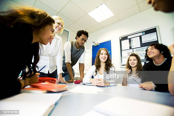 further education: diverse group class project with teacher supervising