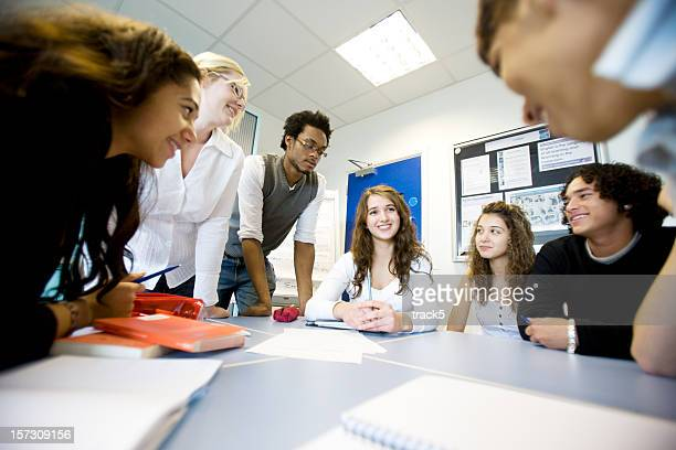 further education: diverse teenagers working on a class project